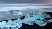 Icebergs at dusk on the beach at Jökulsárlón