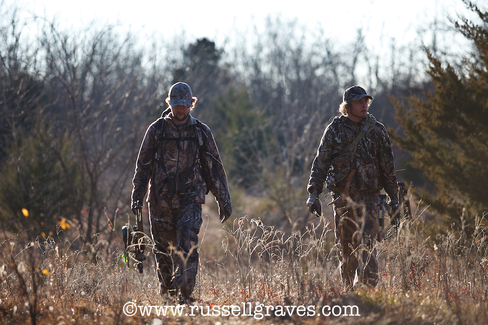 Bowhunters scouting for a location to hunt