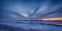 Clouds streaking across the sky, giving life to the icy landscape of Lake Michigan at South Haven