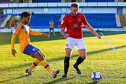 Jamie Reid of Mansfield Town and Harry Davis of Morecambe chase down the ball - Mandatory by-line: Ryan Crockett/JMP - 27/02/2021 - FOOTBALL - One Call Stadium - Mansfield, England - Mansfield Town v Morecambe - Sky Bet League Two