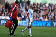 Andre Ayew of Swansea city reacts in pain after taking a knock during play.Barclays Premier league match, Swansea city v Norwich city at the Liberty Stadium in Swansea, South Wales  on Saturday 5th March 2016.<br /> pic by  Andrew Orchard, Andrew Orchard sports photography.