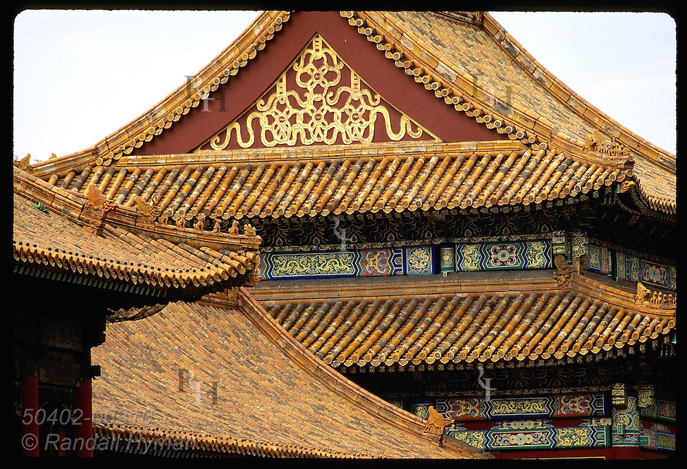 Paintings & gilt on gables & eaves of royal bldg complement tile roof; Forbidden City, Beijing. China