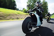 Bike to the future! Slick electric motorcycle cruises 125 miles on just one charge<br /> <br /> The uptake of electric vehicles is usually limited by how far they can travel on a single charge, with experts even coining a new term to describe the feeling of uncertainty over whether you have enough power to reach your destination; 'range anxiety'.<br /> <br /> Now one Austrian company is hoping to tackle the problem with the introduction of the Johammer J1 - an electric bike that can travel 125 miles (200km) on a single charge.<br /> <br /> Created by Bad Leonfelden-based group Johammer, the electric bike has an almost silent motor integrated into the rear wheel.<br /> <br /> The 11 kilowatt hub-mounted motor provides 14 horsepower and a top speed of 74mph (119kph).<br /> <br /> Electric hub-mounted motors contain the electric motor within the wheel hub, or central part of the wheel.<br /> <br /> To drive the wheel, the motor contains a coil which generates an electromagnetic field as power flows through it.<br /> <br /> The field attracts the outer part of the motor, which attempts to follow its direction, and in doing so turns the connected wheel.<br /> <br /> The hub motors eliminates the need for a heavy transmission, gear train, and axles which reduces the weight, making the electric bike far more efficient.<br /> <br /> In place of traditional gauges, the side mirrors have high-resolution displays that show information on the bike's speed and range.<br /> <br /> 'The extreme torsion stiff middle-frame made from aluminium provides space for spring damper and battery pack,' the group writes on their website.<br /> <br /> 'Perfectly balanced (at 350mm mass centre height) the Johammer offers an unmatched and safe driving experience. Steering and footpeg allow for individual adaptation.'<br /> <br /> The bike, which can be purchased from the Johammer, currently comes in silver, white, blue, yellow and green options.<br /> <br /> The J1.150 will set you back £19,000 