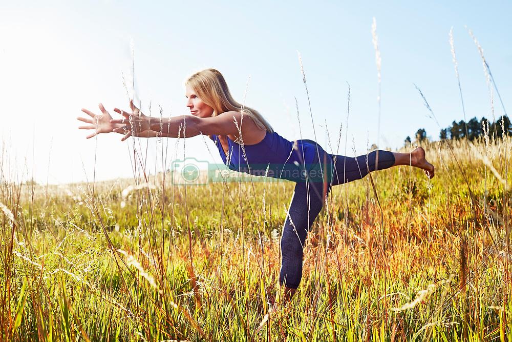 Oct. 11, 2014 - Mature woman practising yoga on field (Credit Image: © Image Source/Image Source/ZUMAPRESS.com)