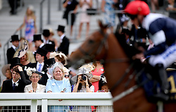 Racegoers watch the action during day five of Royal Ascot at Ascot Racecourse.