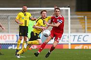 Burton Albion midfielder Stephen Quinn (23) and Accrington Stanley midfielder Sean McConville (11)  during the EFL Sky Bet League 1 match between Burton Albion and Accrington Stanley at the Pirelli Stadium, Burton upon Trent, England on 23 March 2019.