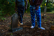 A couple visits the graves of their ancestors at the Rock Springs Annual Camp Meeting in White County, Georgia.<br /> The multi-day religious gathering has been held on the same plot of land since it was founded in 1886 by former<br /> slaves.