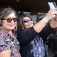 Ernestine Gordon takes a selfie in front of the band at the wine tasting event at Red Rock Park, Wednesday Aug. 8, 2018 with Tina Thompson.