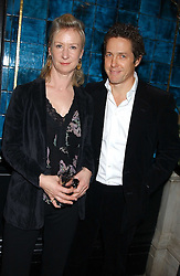 HUGH GRANT and JOANNA JOHNSTON at a party hosted by Tanner Krolle held at Leighton House, 12 Holland Park Road, London W14 on 8th December 2005.<br />