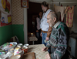 Doctor Kachatur Malakyan and nurse Andrei Bogma of MSF visit the home of Pavlo Virienko, 86, and his wife Lydia, 86, as part of a follow up visit in the home visits project. Pavlo is alone in caring for his frail elderly wife and is scared to venture far from their home due to the recent fighting in the town. He recently fell and cut his face whilst trying to bring home food from a himanitarina food distribution. Their daughter is able to visit once a week but his other daughter lives on the other side of the border in Ukraine and is blocked from visiting her parents due to the security restrictions.