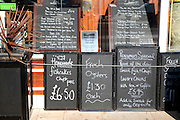 Blackboard menu boards outside a cafe, Scarborough, Yorkshire, England