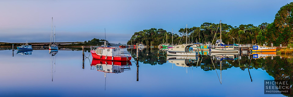 Still waters and reflections feature in this high quality, resolution scene from Strahan on Macquarie Harbour,<br /> <br /> Code: HADW0001<br /> <br /> Limited Edition of 125 Prints