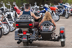 New Jersey Girl gets chaufeured in her sidecar by her son at Greasewood Flats bar during the Hamster Dry Heat Run on Thursday of Arizona Bike Week 2014. USA. April 4, 2014.  Photography ©2014 Michael Lichter.