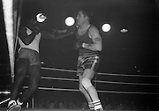 25/01/1963<br /> 01/25/1963<br /> 25 January 1963<br /> National Junior Boxing Championships at the National Stadium, Dublin. Picture shows B. Chadwick (right) of St. Eugene's Boxing Club, Derry, trading blows with J.B. Coker of Dublin University in the Heavyweight Final.