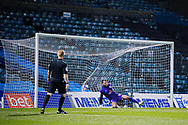 Crewe Alexandra goalkeeper Dave Richards (13) sees the penalty taken by Gillingham FC midfielder Jordan Graham (10) fly past him and into the net during the EFL Sky Bet League 1 match between Gillingham and Crewe Alexandra at the MEMS Priestfield Stadium, Gillingham, England on 26 January 2021..