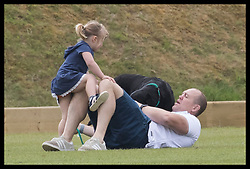 June 11, 2017 - Westonbirt, United Kingdom - Image licensed to i-Images Picture Agency. 11/06/2017. Westonbirt, United Kingdom. Mike Tindall plays with his daughter Mia and their dog  at the Gloucestershire Festival of Polo at Beaufort Polo Club in Westonbirt, Gloucestershire, United Kingdom. Picture by Stephen Lock / i-Images (Credit Image: © Stephen Lock/i-Images via ZUMA Press)
