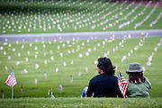 A couple looks out over Punchbowl Cemetery after the flags and lei have been placed in preparation for Memorial Day. Images taken at the National Cemetery of the Pacific in preparation for Memorial Day 2011.