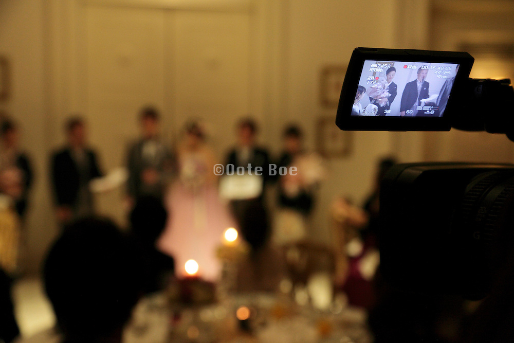 video recording during speech at wedding event