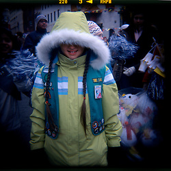 A girl scout models her braids and cold weather jacket at the Chinese New Year Parade held annually in Washington, DC's Chinatown...