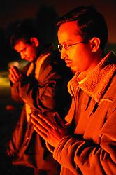 Men praying at the Hindu Holi festival; celebration of colours,