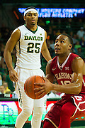 WACO, TX - JANUARY 24: Jordan Woodard #10 of the Oklahoma Sooners drives to the basket against the Baylor Bears on January 24, 2015 at the Ferrell Center in Waco, Texas.  (Photo by Cooper Neill/Getty Images) *** Local Caption *** Jordan Woodard