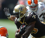 MORNING JOURNAL/DAVID RICHARD.New Orleans Saints running back Reggie Bush rushes against Cleveland.