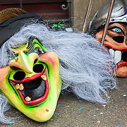 Masks resting on the ground while musicians take a break during Carnival (Fastnacht) in Basel, Switzerland.