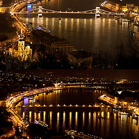 "The combination photo taken on March 26, 2011 shows the Chain Bridge before (Top) and during the ""Earth Hour"" in Budapest, Hungary. The ""Earth Hour"", initiated by the World Wild Fund for Nature (WWF) in 2007, calls on families and buildings to turn off the lights for one hour on the last Saturday night of March. ATTILA VOLGYI"