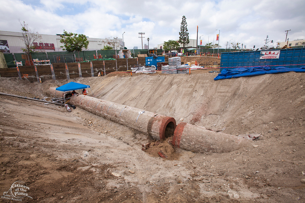 April 25, 2014. Workers clean out a section and prepare the recently unearthed Zanja Madre, or Mother Ditch, for removal to the nearby Metabolic Studios for safe keeping. The 100 foot section and 4 foot diameter of brick pipe was found at a construction site at Chinatown and is a remnant of the 90 mile network of channels that brought water to the early inhabitants of Los Angeles. Originally built in 1781 it was enclosed in 1877 and eventually abandoned in 1904.