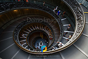A view looking down at the Bramante staircase in Vatican City.