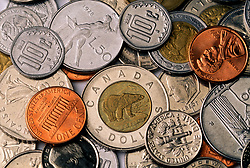 Stock photo of a mixture of American and foreign coins