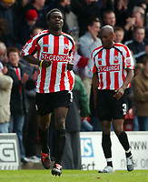 Photo: Daniel Hambury, Digitalsport<br /> Brentford V Bristol City.<br /> Coca Cola League One.<br /> 09/04/2005.<br /> Brentford's Sam Sodje celebrates scoring the first goal.