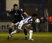 Photo: Chris Ratcliffe.<br /> Colchester United v Swansea City. LDV Vans Trophy. 14/03/2006.<br /> Neil Danns (R) of Colchester tussles with Sam Ricketts of Swansea
