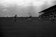 05/09/1965<br /> 09/05/1965<br /> 5 September 1965<br /> All-Ireland Senior Final: Tipperary v Wexford at Croke Park, Dublin.<br /> P. Nealon (Tipperary) with the ball, followed by G.D. Quigley (Wexford).