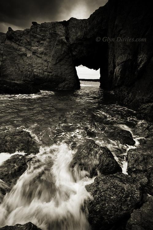 The crumbly limestone rock arch of Bwa Gwyn, Rhoscolyn Head, Anglesey.