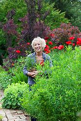 Carol Klein with pots of penstemon
