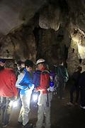 People inside caves, Cueva de la Pileta, near Ronda, Malaga province, southern Spain