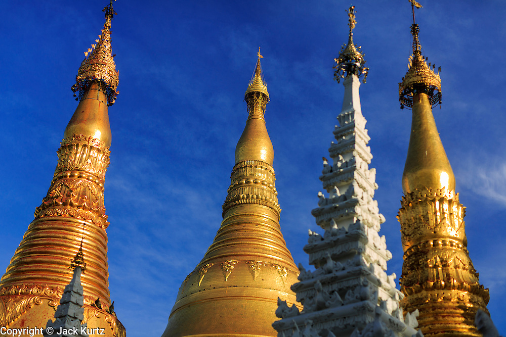 07 JUNE 2014 - YANGON, YANGON REGION, MYANMAR: The roofline of Shwedagon Pagoda in Yangon, Myanmar. Shwedagon Pagoda is officially called Shwedagon Zedi Daw and is also known as the Great Dagon Pagoda and the Golden Pagoda. It's a 99 metres (325ft) gilded pagoda and stupa located in Yangon. It is the most sacred Buddhist pagoda in Myanmar with relics of the past four Buddhas enshrined within: the staff of Kakusandha, the water filter of Koṇāgamana, a piece of the robe of Kassapa and eight strands of hair from Gautama, the historical Buddha.   PHOTO BY JACK KURTZ