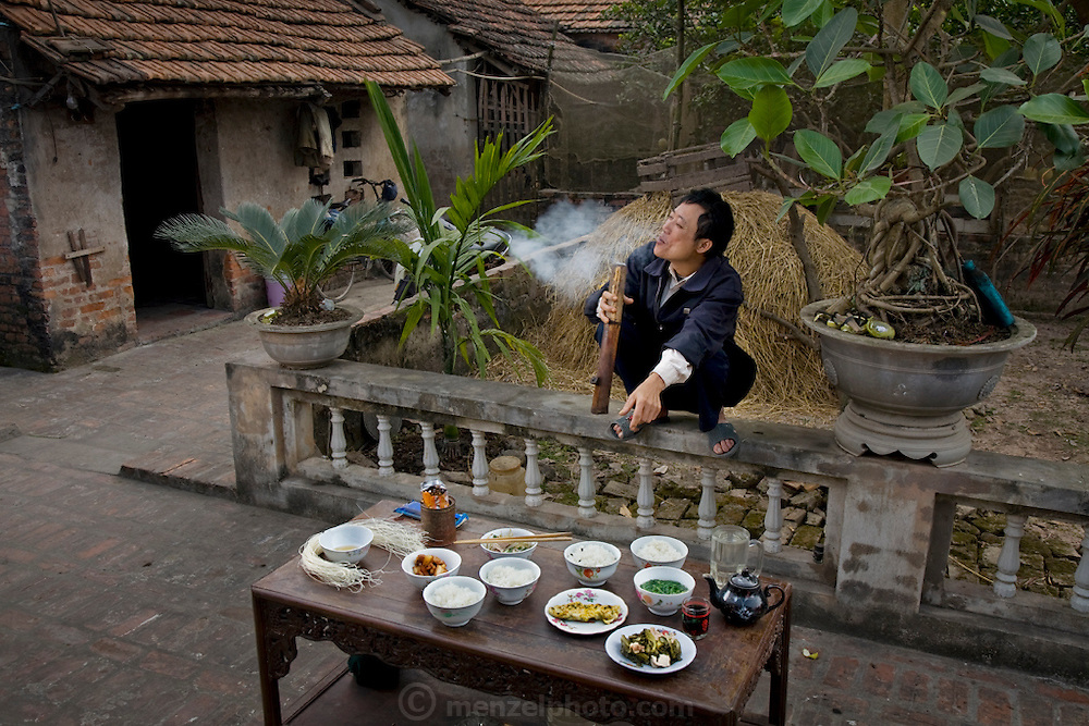 Nguyen Van Theo, a rice farmer, in his courtyard in Tho Quang village, outside Hanoi, Vietnam, with his typical day's worth of food. (From the book What I Eat: Around the World in 80 Diets.) MODEL RELEASED.