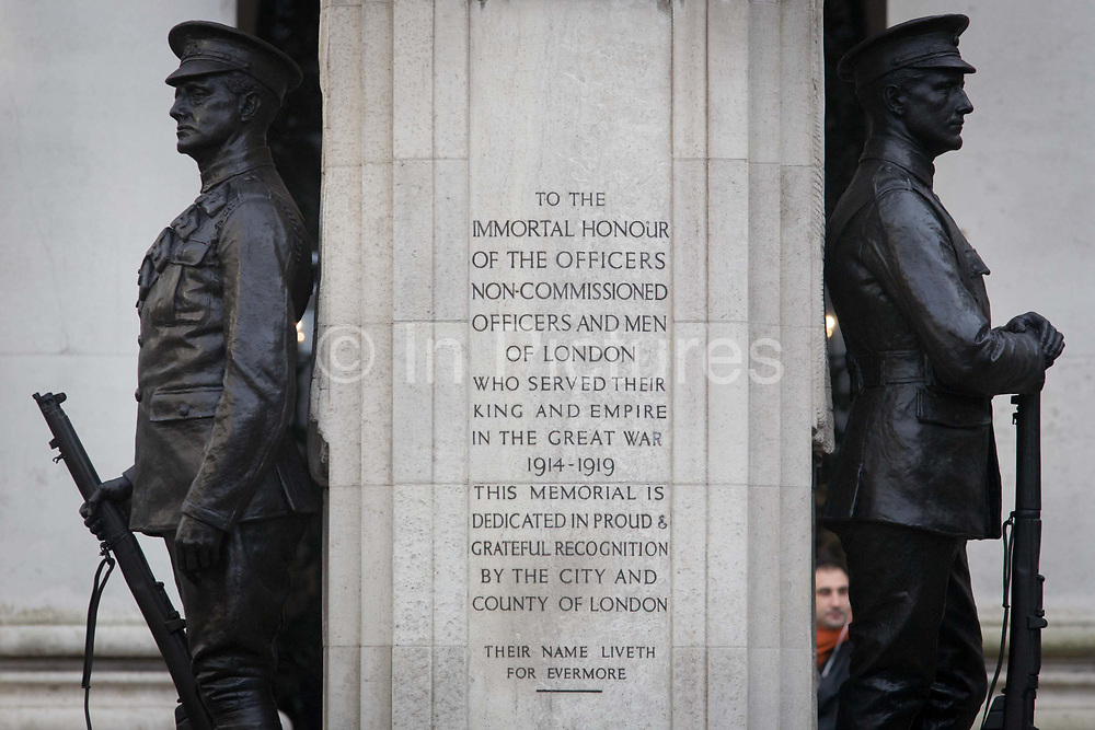 In the 100th year after WW1 started, the war memorial heroes in Cornhill, City of London remembering those killed in the First World War, lost in the trenches and the fields of Flanders from 1914-19. Dedicated by the City of London, the UK capital's financial and historic heart. Two soldiers face away from each other with rifles between their boots, they represent a lost generation when the nation's youth sacrificed their lives in the 20th century's first great conflict. The inscription says that their names will live for evermore.
