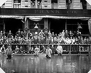 OPS_22-001. Sigmund Frank (center) poses with employees and the crowd in front of the Meier & Frank store during the June, 1894 flood. It was located at 185 First, between Yamhill & Taylor and between First and Second. The Second street and Taylor entrances were several feet above the water line, the First street side was under about 3 feet of water as this photo shows.