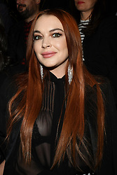 File photo - Actress Lindsay Lohan (R) and her sister Aliana Lohan attend the Saint Laurent show as part of the Paris Fashion Week Womenswear Fall/Winter 2019/2020 on February 26, 2019 in Paris, France. A rumor says that Lohan and the crown prince of Saudi Arabia Mohamed Bin Salman, or MBS, have gotten close, and that he's been flying her around in his jets and showering her with presents, including a gift-wrapped credit card. Photo by Laurent Zabulon/ABACAPRESS.COM