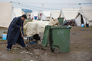 Nea Kavala, Greece - 23.03.2016  <br /> <br /> A refugee prepare his tent for the next rain. 3,515 refugees are currently living in the official Greek refugee camp in Nea Kavala. The Greek military opened the 600 tents big camp about 1 month ago. The conditions in the camp are meager : In case of rain the area is partially submerged also the tents are not heated .<br /> <br /> Ein Fluechtling ruestet sein Zelt fuer den naechsten Regen. 3.515 Fluechtlinge leben derzeit in dem offiziellen griechischen Fluechtlingscamp in Nea Kavala. Das griechische Militaer eröffnete das aus 600 Zelten bestehende Lager etwa 1 Monat vorher. Die Bedingungen im Lager sind dürftig: Bei Regen steht das Gelaende teilweise unter Wasser außerdem sind die Zelte nicht geheizt.