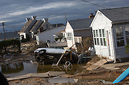 Ortley Beach, New Jersay, November 3, 2012,    Damaged homes and a car on a street moved by the surge produced by  after Hurricane Sandy  that flooded the entire barrier island. The Jersey shore took the brunt of Hurricane Sandy.