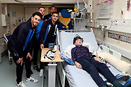 AFC Wimbledon defender Will Nightingale (5), AFC Wimbledon attacker Egli Kaja (21), AFC Wimbledon midfielder Anthony Hartigan (8). AFC Wimbledon defender Rod McDonald (26). Haydon the Womble delivering Christmas presents to the children on behalf of AFC Wimbledon, at St George's Hospital, Tooting, United Kingdom on 13 December 2018.