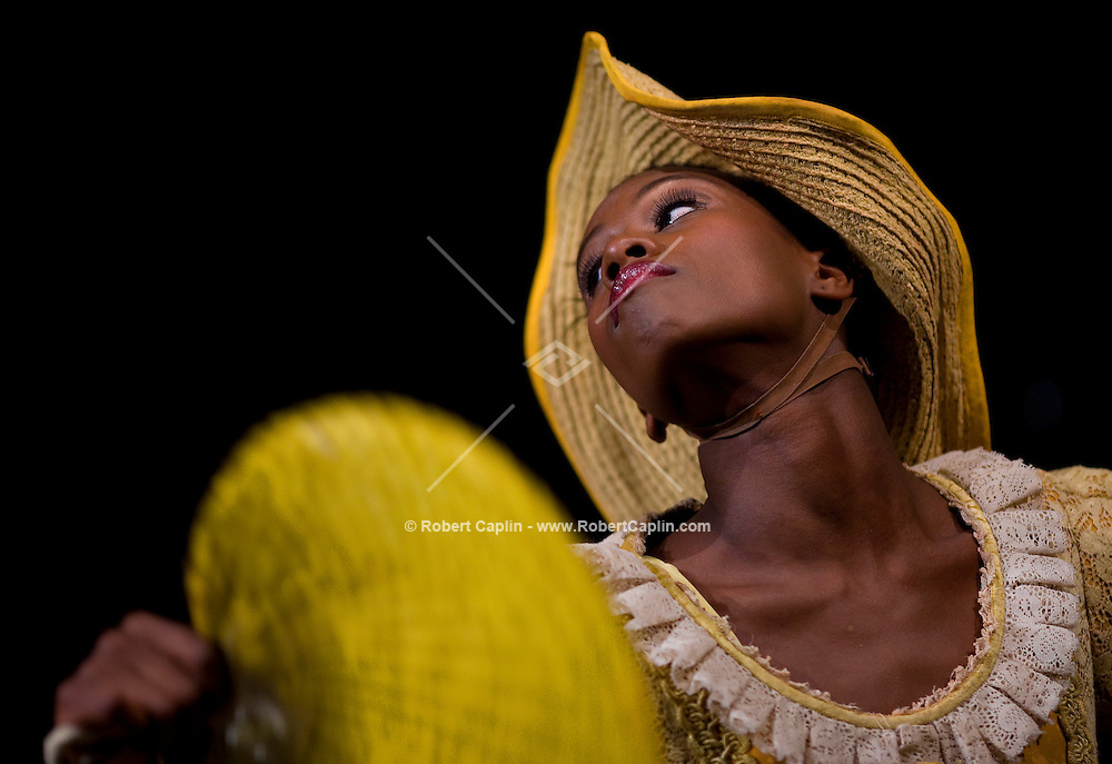 A dancer with the Alvin Ailey American Dance theater works with dancers during a rehearsal of the company's 50th Anniversary Launch Event being held Thursday. Taken March 26, 2008. Photographer: Robert Caplin For The New York Times..