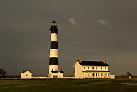 NC01298-00...NORTH CAROLINA - The sun comes out at sunset after a very wet day at Bodie Island Lighthouse; part of Cape Hatteras National Seashore.