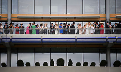 © Licensed to London News Pictures. 19/06/2018. London, UK.  Racegoers watch members of the Royal Family arrive at day one of Royal Ascot at Ascot racecourse in Berkshire, on June 19, 2018. The 5 day showcase event, which is one of the highlights of the racing calendar, has been held at the famous Berkshire course since 1711 and tradition is a hallmark of the meeting. Top hats and tails remain compulsory in parts of the course. Photo credit: Ben Cawthra/LNP