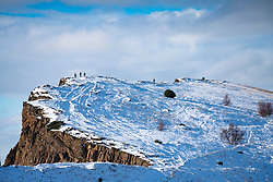 View of Salisbury Crags covered in snow in winter in Holyrood Park, Edinburgh, Scotland, UK