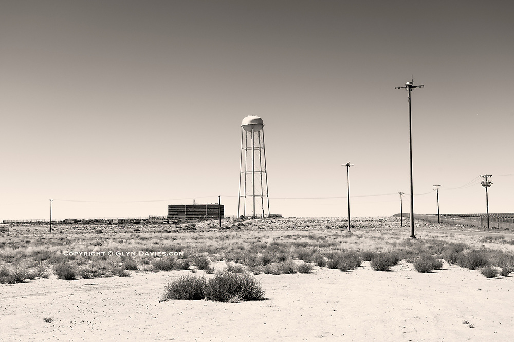 2020 - 15th B&W SPider Awards - Nominee in Fine Art<br /> <br /> I was fascinated by the strangely sculptural but definitely incongruous water towers dotted across the New Mexico landscape. Literally in the middle of nowhere with hundreds of acres of nothingness around, these structures stick up out of the flat plains.  <br /> <br /> This one, just off the historic Route 66 really caught my eye, so we detoured to get to it, finding ourselves at the gates of the Albuquerque Detention Centre! As numerous B&W Sheriff cars drove past I was super anxious about being detained myself, for taking pictures there, but I genuinely was just interested in the water tower. They must have thought I was more weird than dangerous, so left me to it :-)